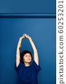 Cropped view of beautiful woman stretching with hands overhead. 60253201