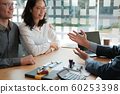 couple consulting lawyer about buying renting 60253398