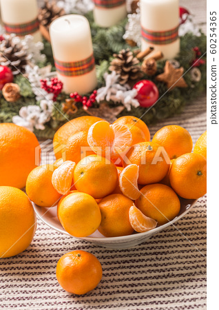 Tangerines and oranges on christmas table with 60254365