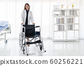 Doctor hold Wheelchair 60256221