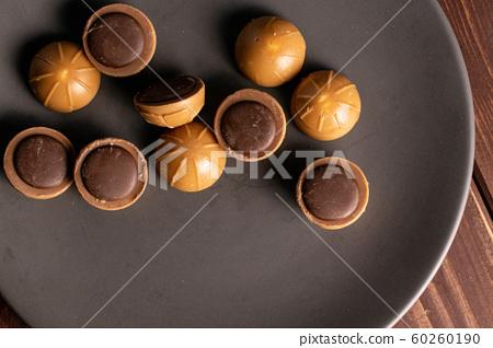 Sweet brown toffee on brown wood 60260190