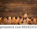 fallen dry leaves on wooden plank background 60262333