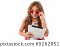 Little pretty caucasian girl holds a big tablet, picture isolated on white background 60262851