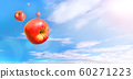 Multiple red apples flying in the blue sky with clouds 60271223