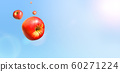 Multiple red apples flying in fine weather 60271224