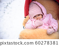 Cute baby in stroller on frosty winter day. Baby 60278381