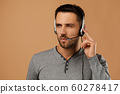 Call center worker man on white background. 60278417
