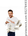 man throwing out money banknotes 60278493