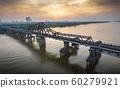 Long Bien Bridge and Red River, Ha Noi, Viet Nam. Panorama Aerial Drone Shot in Sunset 60279921