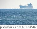 Big ship mirage on sea horizon line 60284582