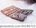 Snow-covered set of car tools in the snow. The concept of breakdowns and malfunctions of diesel and gasoline cars in the winter, poor-quality diesel fuel, problem engine start 60286722