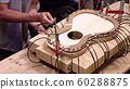 Building a guitar with spring clamps 60288875