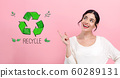 Recycle with young woman 60289131