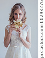 the bride at a wedding in room eating white chocolate 60293276
