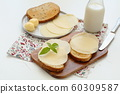 Toasts with butter and cheese 60309587