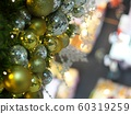 Christmas and New Year festival style golden colour ornaments decorate on green pine tree in a shopping center crop closeup with blur indoor environment  background 60319259