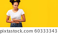 Upset african american woman suffering from stomachache 60333343