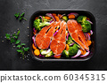 Salmon. Cooking fresh raw salmon fish steaks with 60345315
