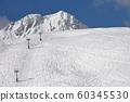 Skiing slopes sunny weather 60345530
