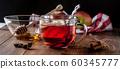 Tea with lemon and cinnamon inside  on table 60345777
