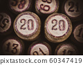 Vintage wooden lotto kegs with two numbers 20 and 20 as symbol of 2020 year. Close-up top view of 2019 New Year inscription. Vignette, brown toning, vintage instant color photo effect old film 60347419