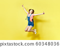 Girlish, funky, happiness, dream, fun, joy, summer concept. Very excited happy cute girl is jumping up, in summer outfit, on yellow background 60348036