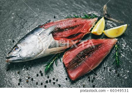 Fresh fish fillet sliced for steak or salad with 60349531