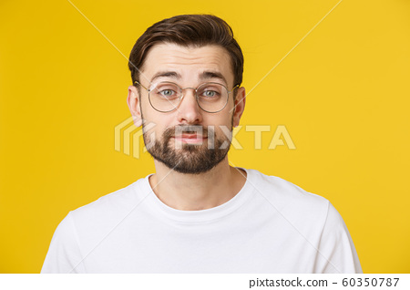 Young casual man portrait isolated on yellow background 60350787
