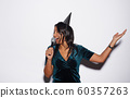Beautiful Woman Singing at Birthday Party 60357263