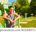 Young man relaxing after outdoor workout 60368071