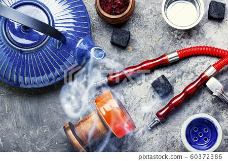 Turkish smoking hookah and tea. 60372386