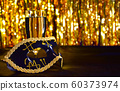 Golden mask, champagne with gold bokeh background. 60373974