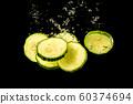 Sliced cucumber splashing water isolated on black 60374694
