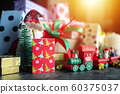 Santa Claus doll, gift box present and christmas ornament for christmas greeting seasonal background. selective focus 60375037