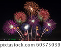 real fireworks festival in the sky for celebration at night over the sea at coast side for new year countdown celebration background 60375039