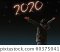 happy Asian girl open arm with joyful on countdown night with firework light for 2020 year. image of happy new year celebration party for seasonal and holiday background wallpaper 60375041