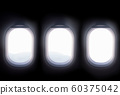 three airplane windows open white window shutter wide.out to view of mountain hilltop during travel by air 60375042