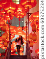 Woman enjoying traditional red lanterns decorated for Chinese new year Chunjie 60375234