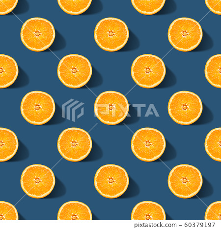 Seamless pattern of orange sliced on classic blue color background. Minimal, flat lay. 60379197