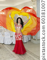 Oriental dancer in a red-yellow dress. 60381007