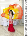 Oriental dancer in a red-yellow dress. 60381009