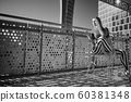 Woman on the balcony on a sunny day.. BW photo 60381348