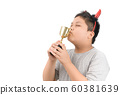 Obese fat child kissing golden winning cup 60381639