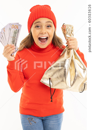 European girl with money in hand screams with joy on a white background with copyspace 60383616