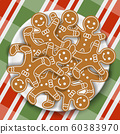 Holiday gingerbread man cookies in plate on colored Christmas gingham tablecloth 60383970