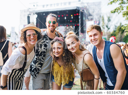 Group of young friends at summer festival. 60384760