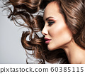 Face of a beautiful  woman with long flying   hair 60385115