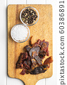 Beef jerky pieces. Dried beef meat. 60386891