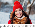 Winter smiling young woman in park. Winter holiday concept 60388910