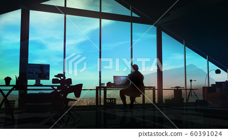 The silhouette of a videographer at a workplace in his office. 60391024